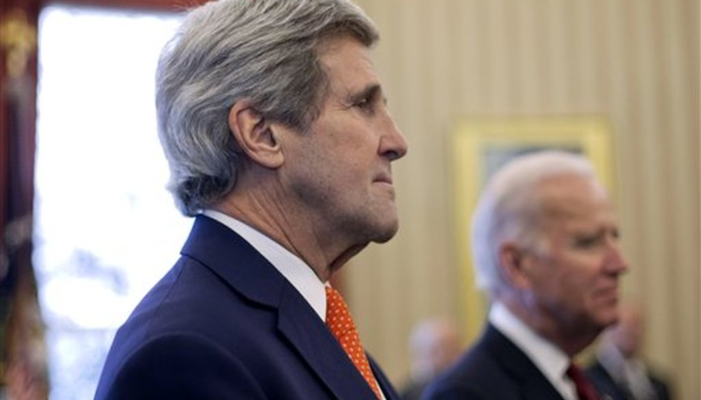 Former Secretary of State John Kerry and Vice President Joe Biden listen to President Barack Obama answer questions on Ukraine on March 3, 2014, at the White House in Washington. (AP/Monsivais)