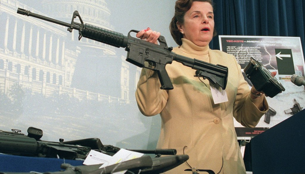 Sen. Dianne Feinstein, D-Calif., holds an AR-15 assault-style rifle with a collapsible stock during a Capitol Hill news conference Friday, March 22, 1996 after the House voted to repeal the two-year-old assault-style firearms ban.