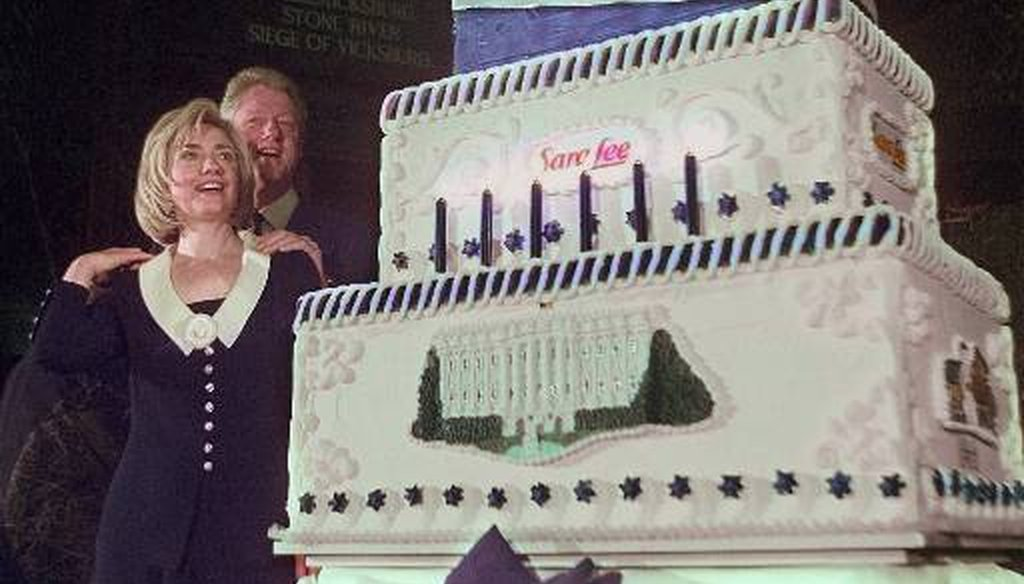 Then-first lady Hillary Rodham Clinton eyes her birthday cake as President Bill Clinton looks on during a celebration of her 50th birthday in October 1997. (AP)