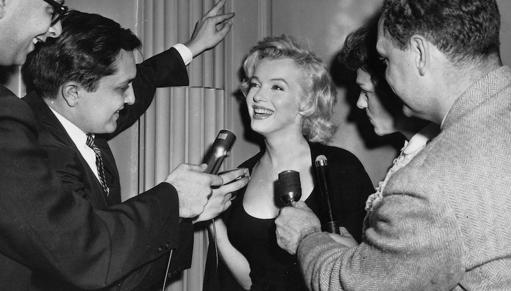 Marilyn Monroe questioned by news reporters in New York City.
