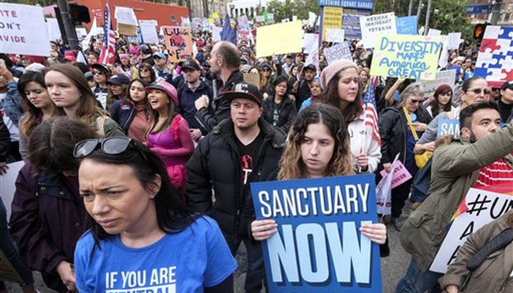 """Thousands of people take part in the """"Free the People Immigration March,'' to protest actions taken by President Donald Trump and his administration, in Los Angeles on Feb. 18, 2017. (AP/Ringo H.W. Chiu)"""