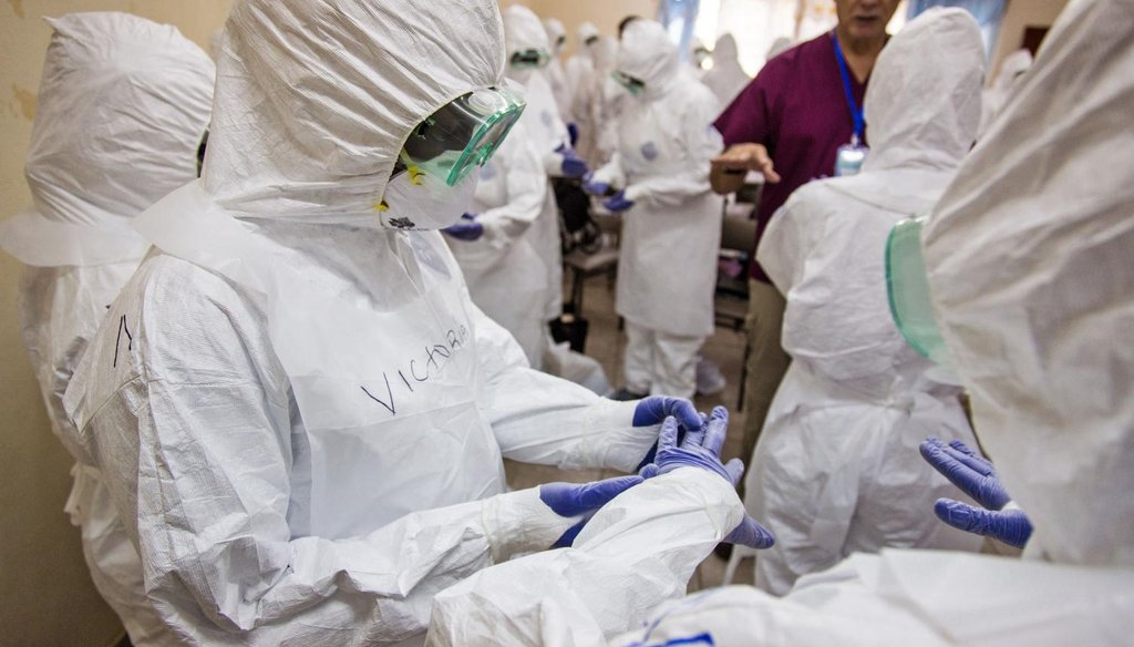 A World Health Organization worker, right rear, trains nurses to use Ebola protective gear in Freetown, Sierra Leone, Sept. 18, 2014. (AP)