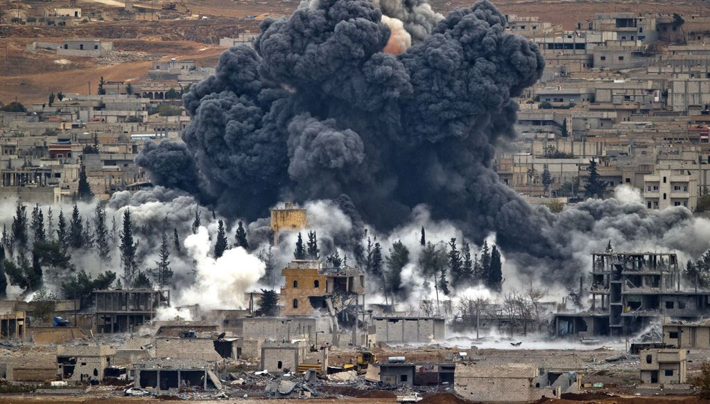 Smoke rises from the Syrian city of Kobani, following an airstrike by the U.S.-led coalition, seen from a hilltop outside Suruc, on the Turkey-Syria border on Nov. 17, 2014.