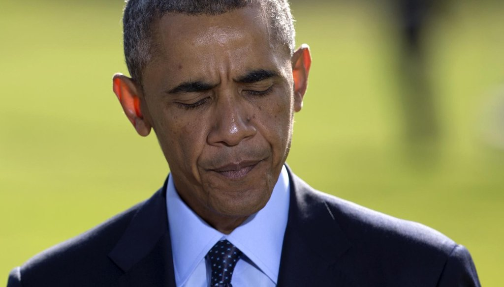 President Barack Obama pauses as he speaks about the participation of five Arab nations in airstrikes against militants in Syria on  Sept. 23, 2014, on the South Lawn the White House. (AP/Carolyn Kaster)