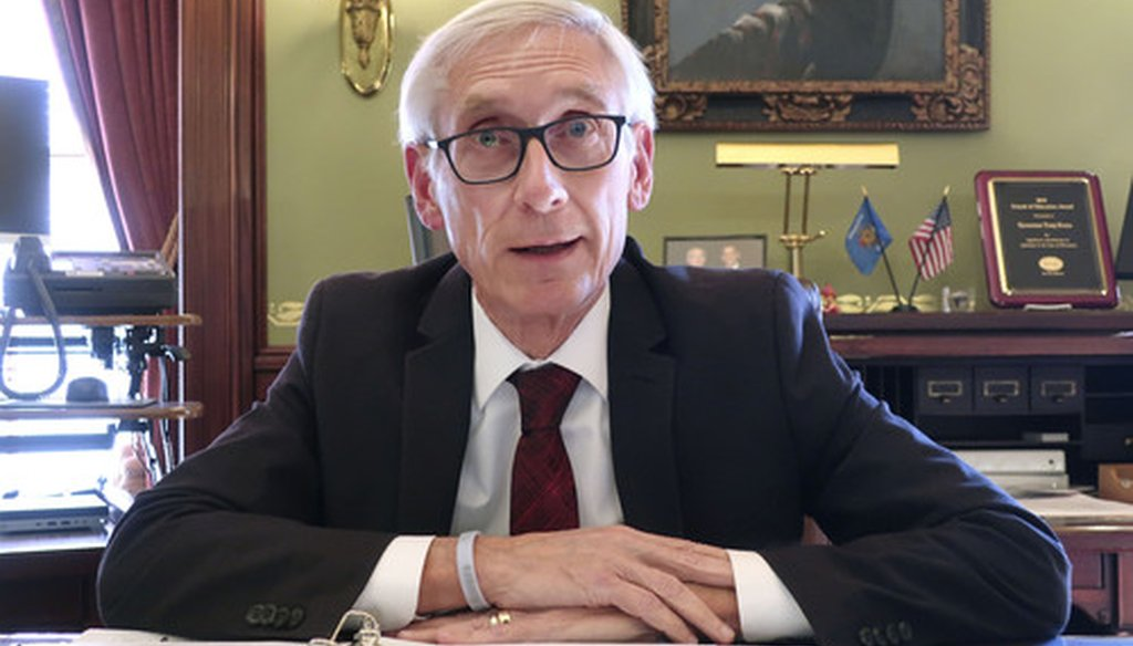 Gov. Tony Evers drew criticism from open records advocates and journalists after his office refused to release a day's worth of emails. The governor said state law doesn't allow it.  Amid criticism, Evers later decided to release the emails. AP