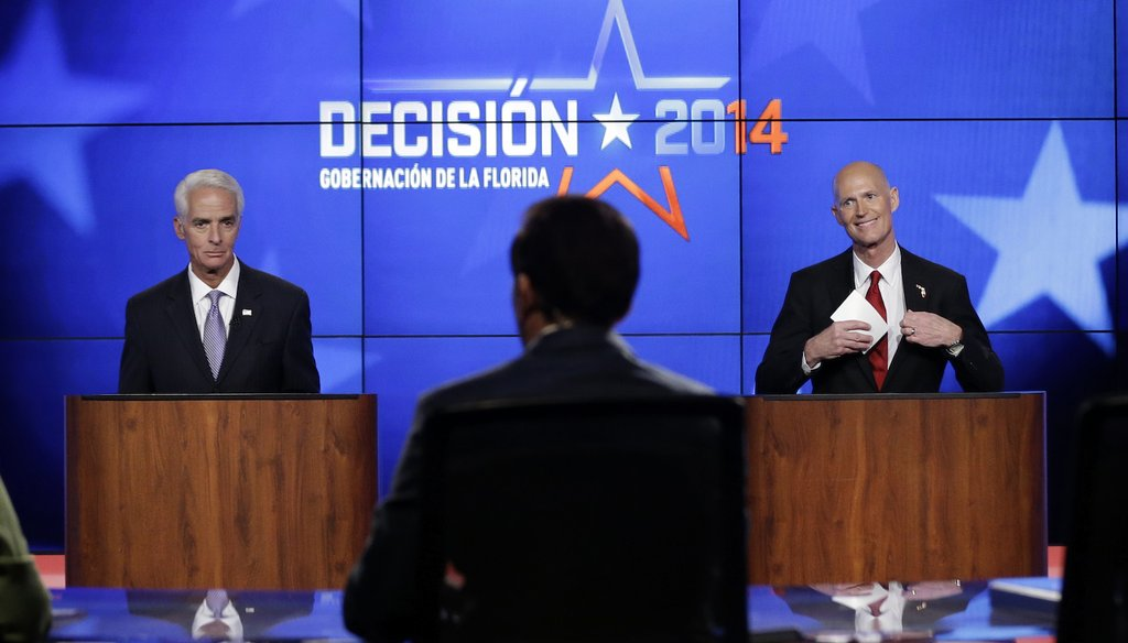 Charlie Crist and Rick Scott appear together in their first debate, on Oct. 10, 2014, at Telemundo studios in Miramar. (AP photo)