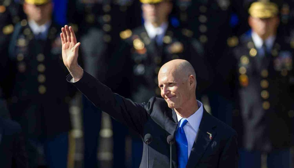 Florida Gov. Rick Scott waves after the swearing in for his second term at the Florida state capitol, Jan. 6, 2015. (AP Photo)