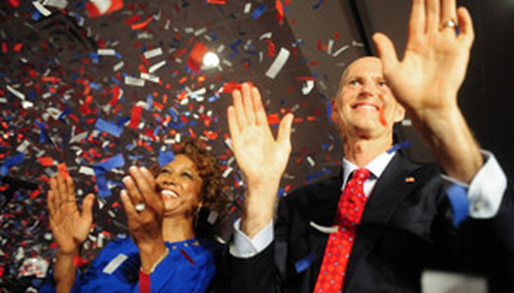 Florida Gov.-elect Rick Scott and Lt. Gov.-elect Jennifer Carroll wave to the crowd after Scott's acceptance speech Nov. 3, 2010.