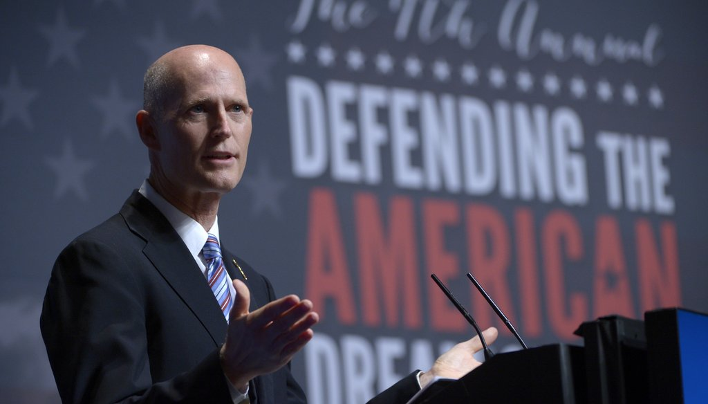 Gov. Rick Scott speaks at the Americans for Prosperity Foundation's Defending the Dream Summit on Aug. 30. Photo by Associated Press.