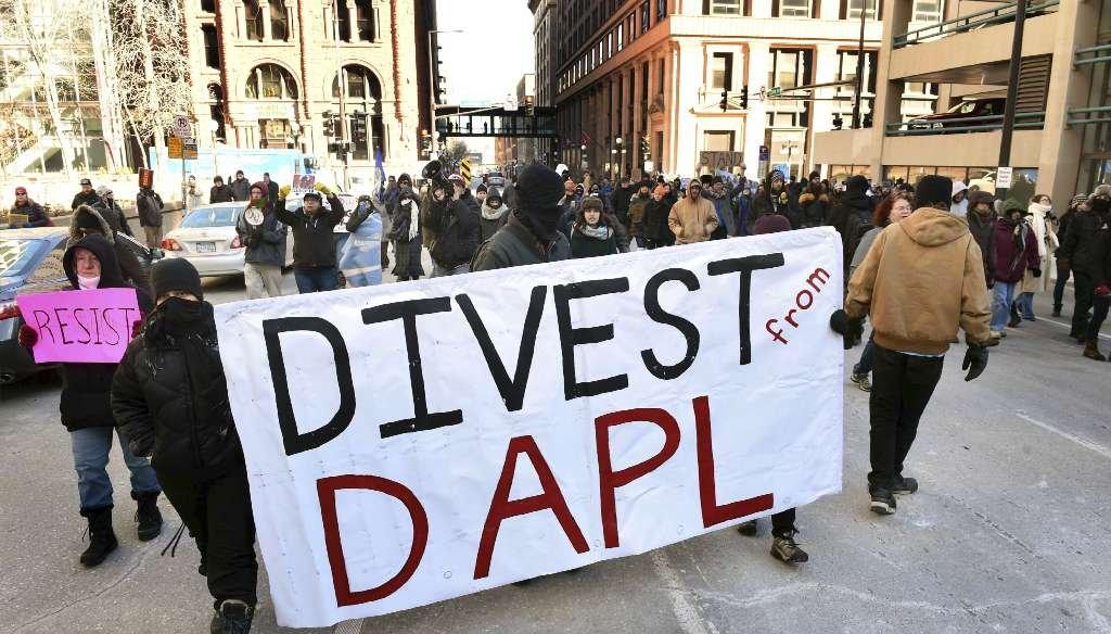 Protesters against the Dakota Access Pipeline march through St. Paul, Minn., on Feb. 9, 2017. (AP photo)