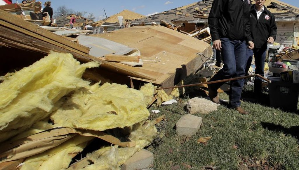 Missouri Gov. Eric Greitens surveys damage to homes that were destroyed by a tornado Tuesday, March 7, 2017, after a severe storm passed through Oak Grove, Mo.