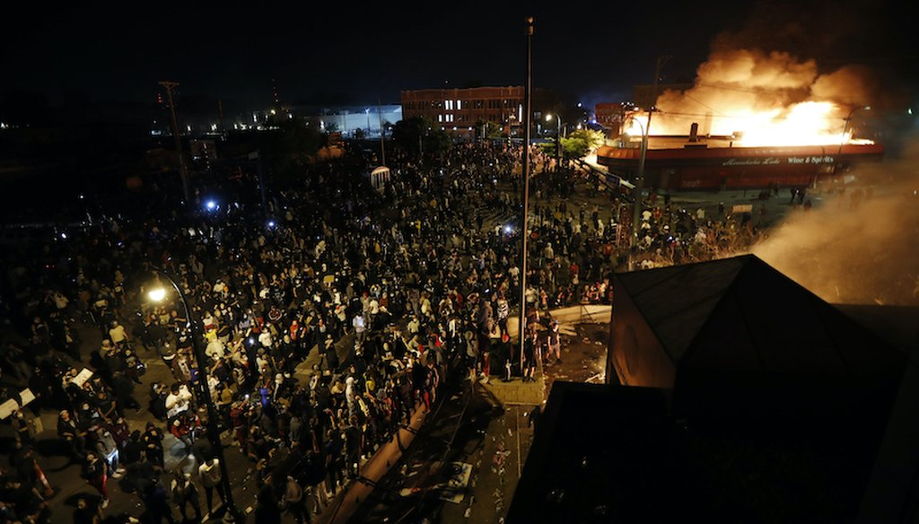 Protesters demonstrate outside of a burning Minneapolis 3rd Police Precinct on May 28, 2020, in Minneapolis. (AP/Minchillo)