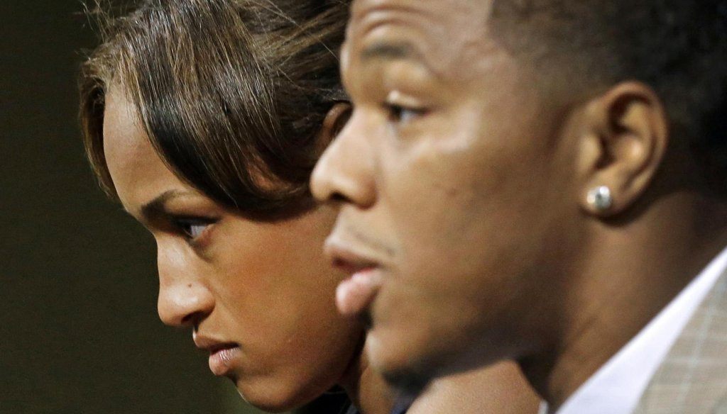 Janay Rice, left, looks on as her husband, former Baltimore Ravens running back Ray Rice, speaks to the media during a May 23, 2014, news conference. (AP)