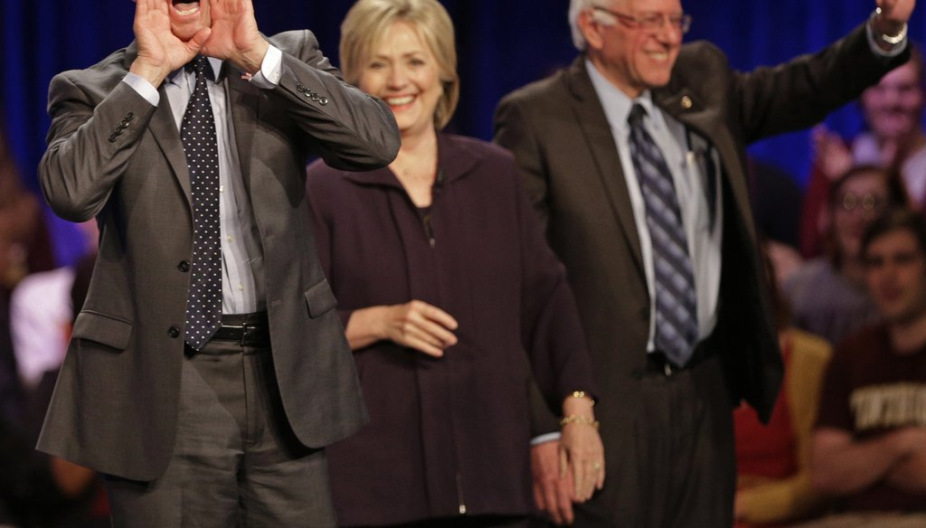 Former Maryland Gov. Martin O'Malley shouts to supporters as Hillary Clinton and Sen. Bernie Sanders, I-Vt, wave to supporters on Nov. 6, 2015. (AP Photo)
