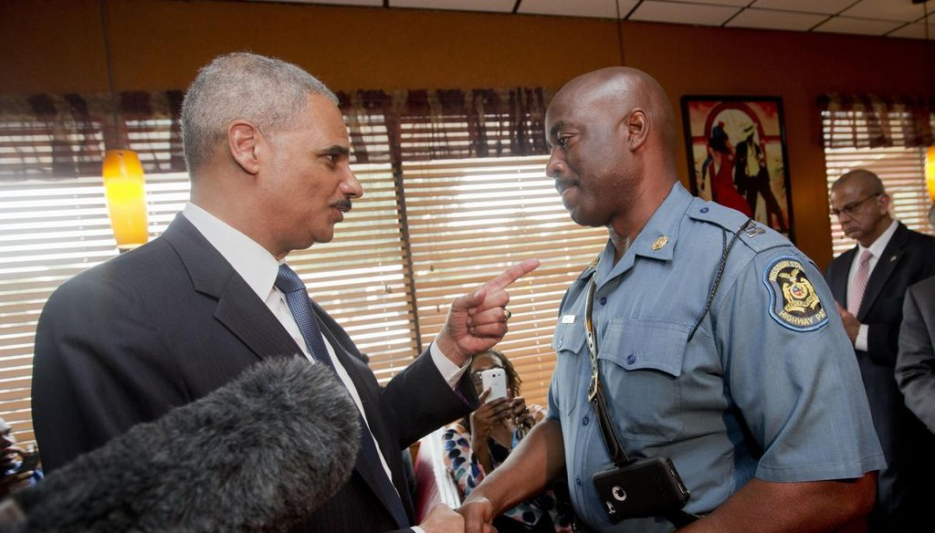 Attorney General Eric Holder talking with Capt. Ron Johnson of the Missouri State Highway Patrol at Drake's Place Restaurant in Florrissant, Mo. (AP)
