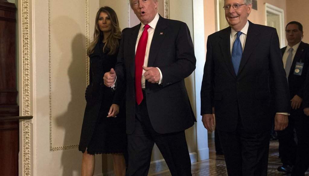 In this Nov. 10, 2016, photo, President-elect Donald Trump, accompanied by his wife Melania, and Senate Majority Leader Mitch McConnell of Ky., gestures while walking on Capitol Hill in Washington. (AP Photo/Molly Riley)