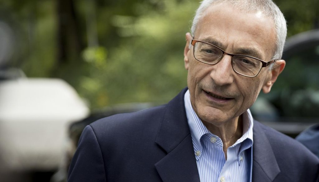 Hillary Clinton's campaign manager John Podesta speaks to members of the media outside Democratic presidential candidate Hillary Clinton's home in Washington. (AP)