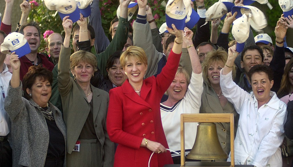Carly Fiorina, then-chief executive of Hewlett-Packard, rings a bell to virtually open the New York Stock Exchange on May 6, 2002, after the company changed its ticker symbol from HWP to HPQ to reflect its acquisition of Compaq Computer Corp. (AP Photo)