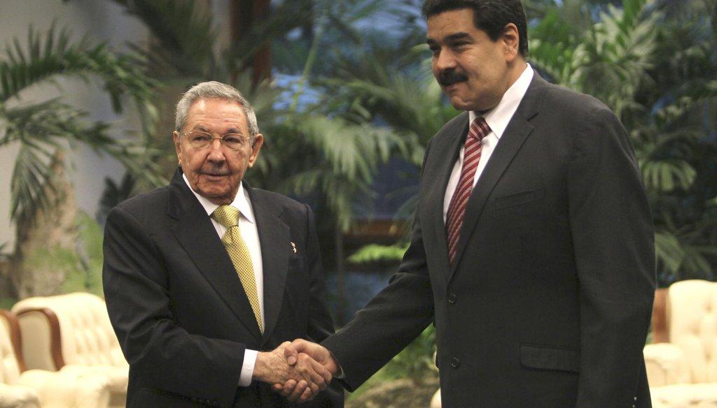 Cuba's President Raul Castro, left, shakes hands with Venezuela's President Nicolas Maduro, before the ALBA summit at Revolution Palace in Havana, Dec. 14, 2014. (AP)