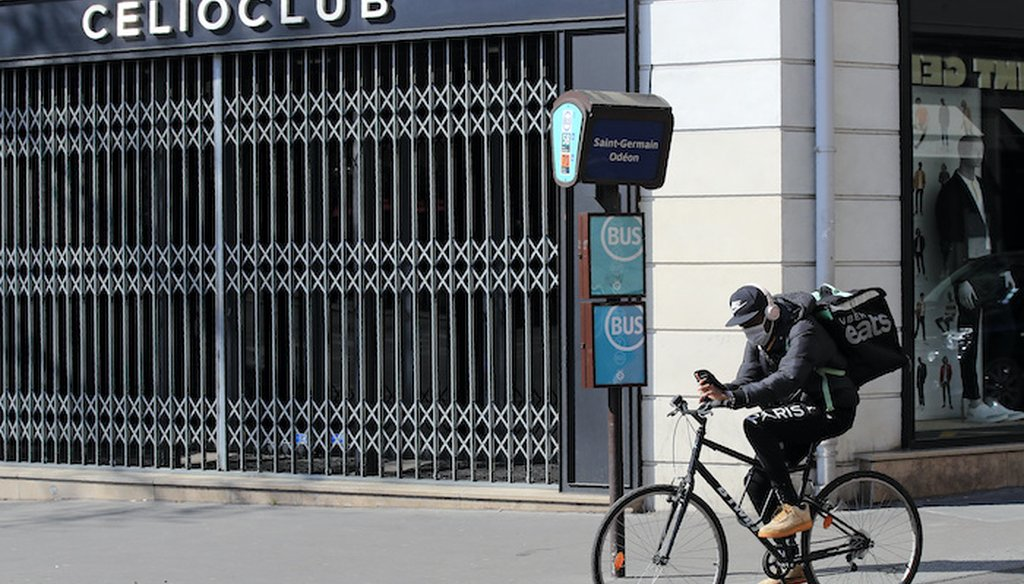 A man of a food delivery service rides his bike in Paris, Thursday, March 19, 2020. (Associated Press)