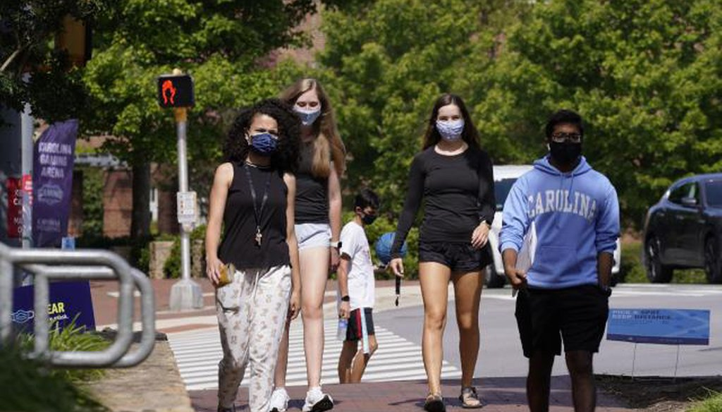 Students wear masks on campus at the University of North Carolina in Chapel Hill, N.C., Tuesday, Aug. 18, 2020. (AP/Gerry Broome)