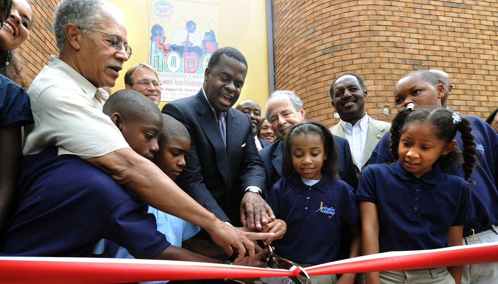 Atlanta Mayor Kasim Reed, center, and Skye Moten, 9, Naiya Portillo, 10, cut the ribbon to officially re-open the Central Park Recreation Center in August 2010. Photo by Johnny Crawford of The Atlanta Journal-Constitution.