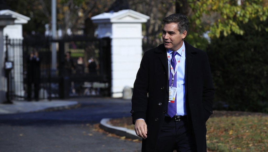 CNN's Jim Acosta walks on the North Lawn driveway upon returning back to the White House in Washington, Friday, Nov. 16, 2018. (AP)