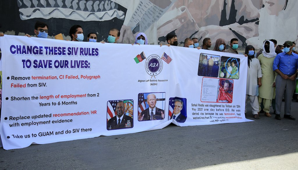 In this June 25, 2021 photo, former Afghan interpreters hold placards during a demonstrations against the US government, in front of the US Embassy in Kabul, Afghanistan. (AP)