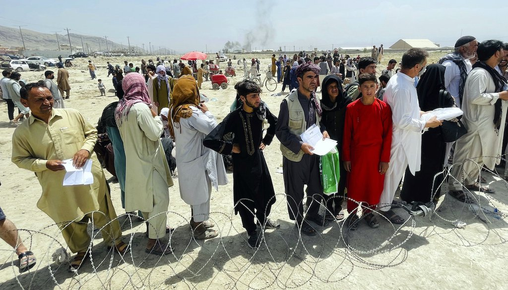 Hundreds of people gather outside the international airport in Kabul, Afghanistan, Tuesday, Aug. 17, 2021. (AP)