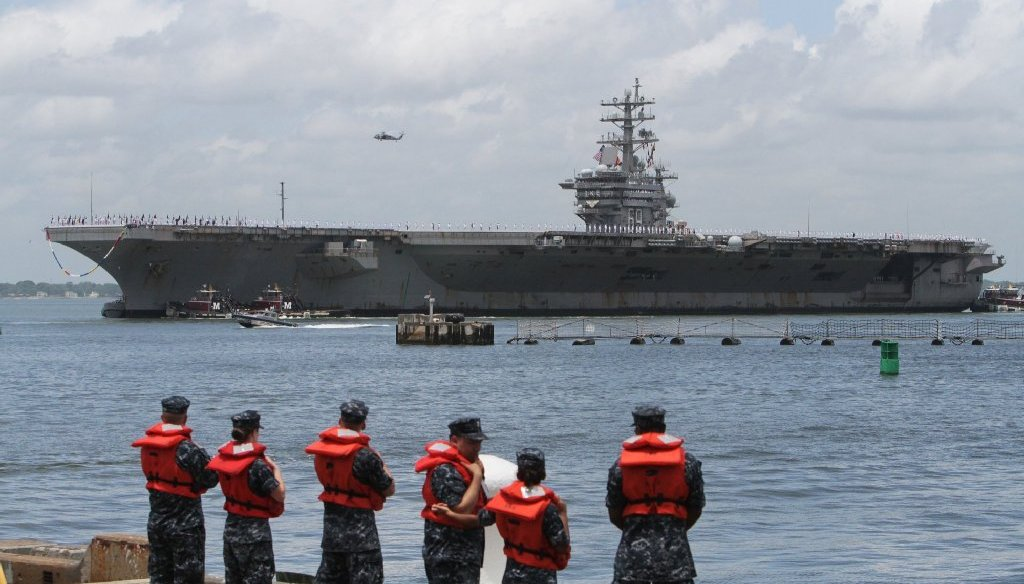 The USS Dwight D. Eisenhower arrives back at the Norfolk Naval Station on July 3, 2013. (Photo by AP/The Virginian-Pilot)