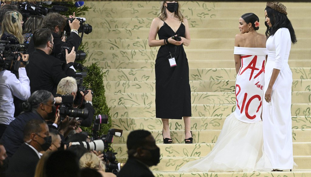 """Rep. Alexandria Ocasio-Cortez, D-N.Y., wore a dress that said """"tax the rich"""" to a gala in New York City on Sept. 13, 2021. (Photo by NDZ/STAR MAX/IPx)"""