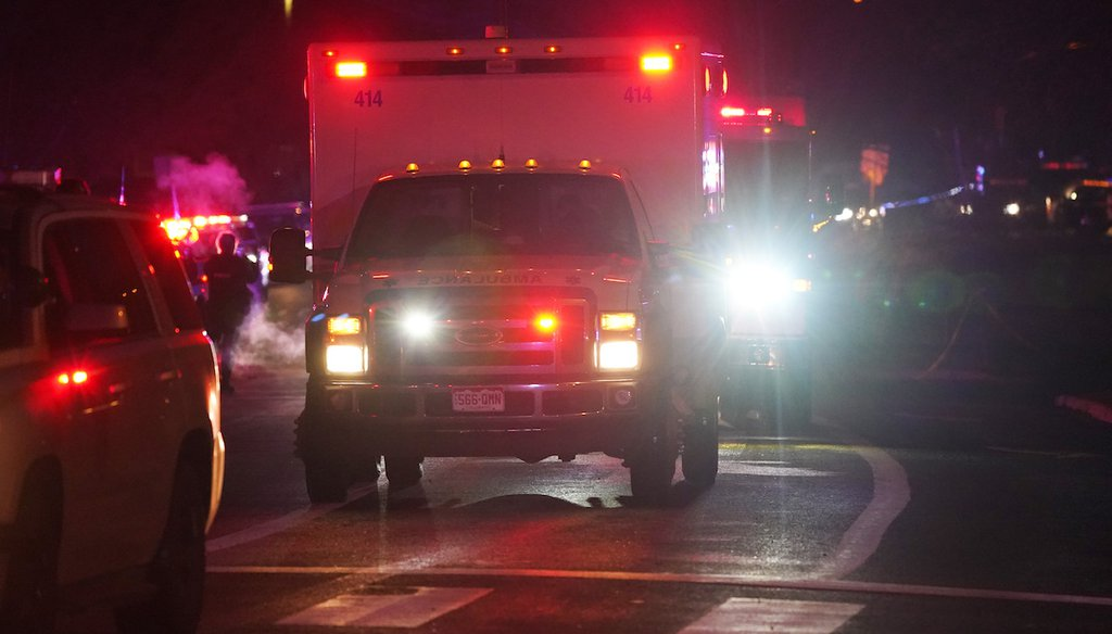 A line of ambulances leaves a King Soopers grocery store where 10 people died  in a shooting in Boulder, Colo. (AP Photo/David Zalubowski)