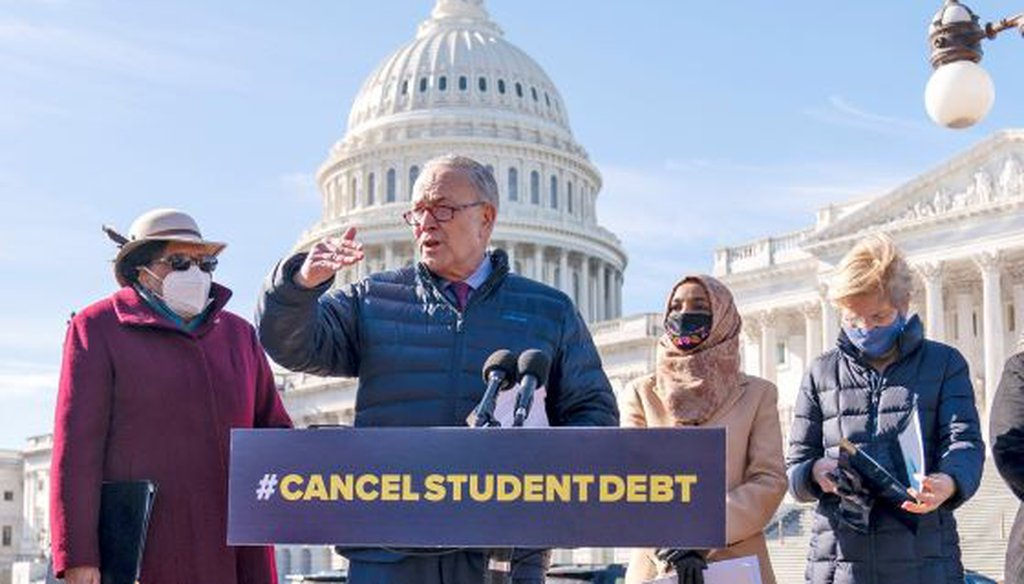 Senate Majority Leader Sen. Chuck Schumer, accompanied by Sen. Elizabeth Warren and others, including Rep. Alma Adams, call for forgiving student loan debt on Feb. 4, 2021, in Washington. (Andrew Harnik/AP)