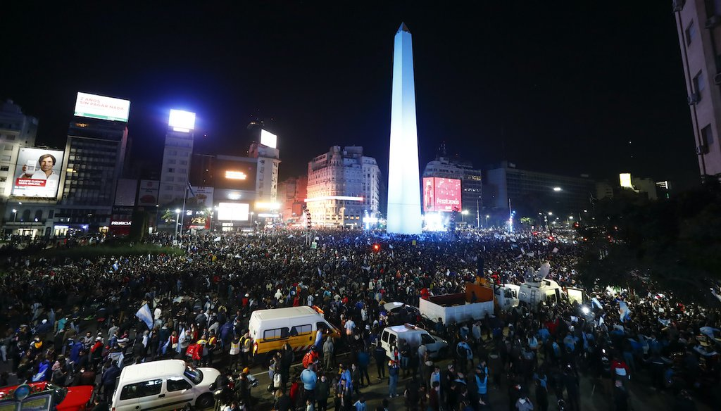 Argentina fans celebrate winning the Copa America final soccer match against Brazil in Buenos Aires, Argentina, Saturday, July 10, 2021. A video from the scene is being miscaptioned on social media as if it shows Cuba protests. It does not. (AP)