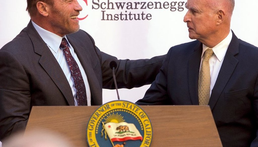 Former Gov. Arnold Schwarzenegger, left, shakes hands with Gov. Jerry Brown during a celebration of the 10th Anniversary of Schwarzenegger signing California's landmark global warming bill, AB32, Oct. 5, 2016, in Sacramento, Calif.