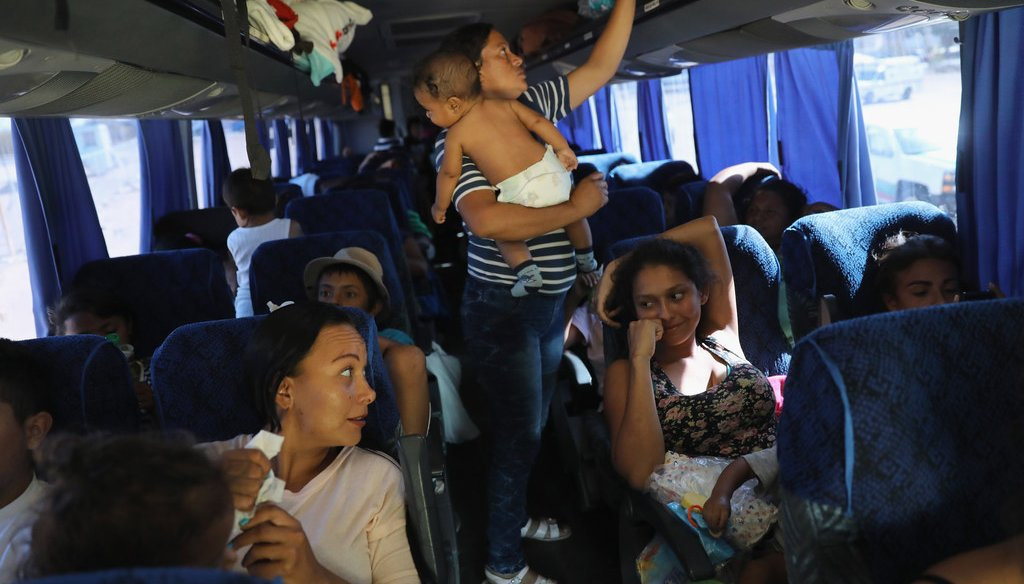 Central American asylum seekers ride a bus to Tijuana on April 25, 2018, while passing through San Luis Rio Colorado along the U.S.-Mexico border. (Getty Images)