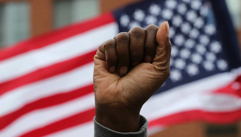 Baltimore residents celebrate after Marilyn Mosby, Baltimore City state's attorney, said six police will be charged in the death of Freddie Gray while in police custody. (Getty Images)