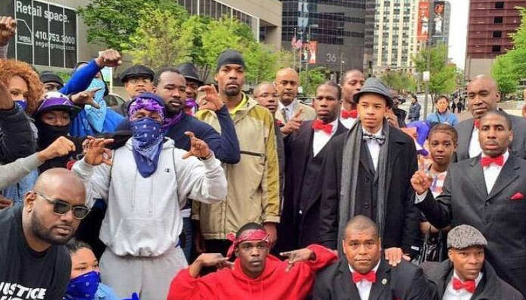 Representatives of the Nation of Islam and two gangs, the Crips and the Bloods, at a rally against police violence in Baltimore, Md.