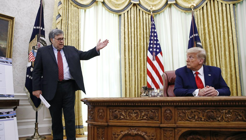 In this July 15, 2020, file photo Attorney General William Barr, left, speaks with President Donald Trump during a a law enforcement briefing on the MS-13 gang in the Oval Office of the White House in Washington. (AP)