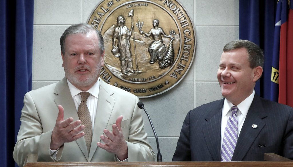 N.C. Senate President Pro Tem Phil Berger, left, and N.C. House Speaker Tim Moore talk during a news conference at the Legislative Building in Raleigh, N.C., Thursday, May 17, 2018. (via The News & Observer)