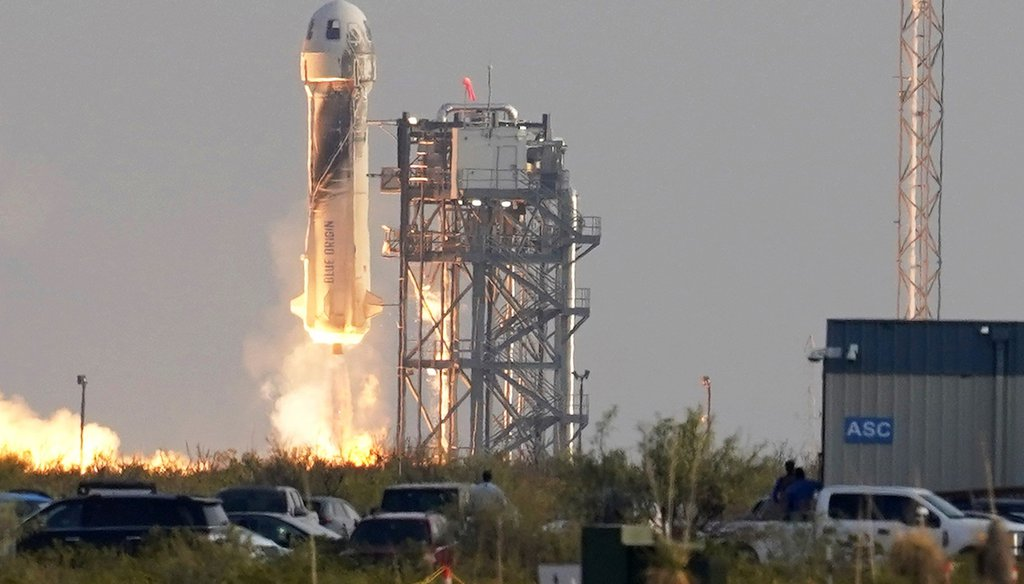 Blue Origin's New Shepard rocket Jeff Bezos, founder of Amazon and space tourism company Blue Origin, his brother Mark Bezos, Oliver Daemen and Wally Funk, from its spaceport near Van Horn, Texas. (AP Photo/Tony Gutierrez)