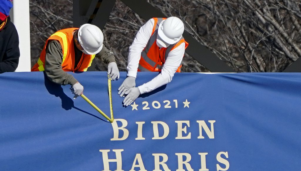 Workers put up bunting on a press riser for the upcoming inauguration of President-elect Joe Biden and Vice President-elect Kamala Harris, on Pennsylvania Ave. in front of the White House, Thursday, Jan. 14, 2021, in Washington. (AP)