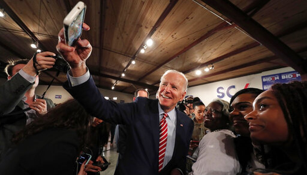 Democratic presidential candidate, former Vice President Joe Biden, takes a photo with a supporter's camera after speaking at a campaign event in Columbia, S.C., Tuesday, Feb. 11, 2020. (AP)