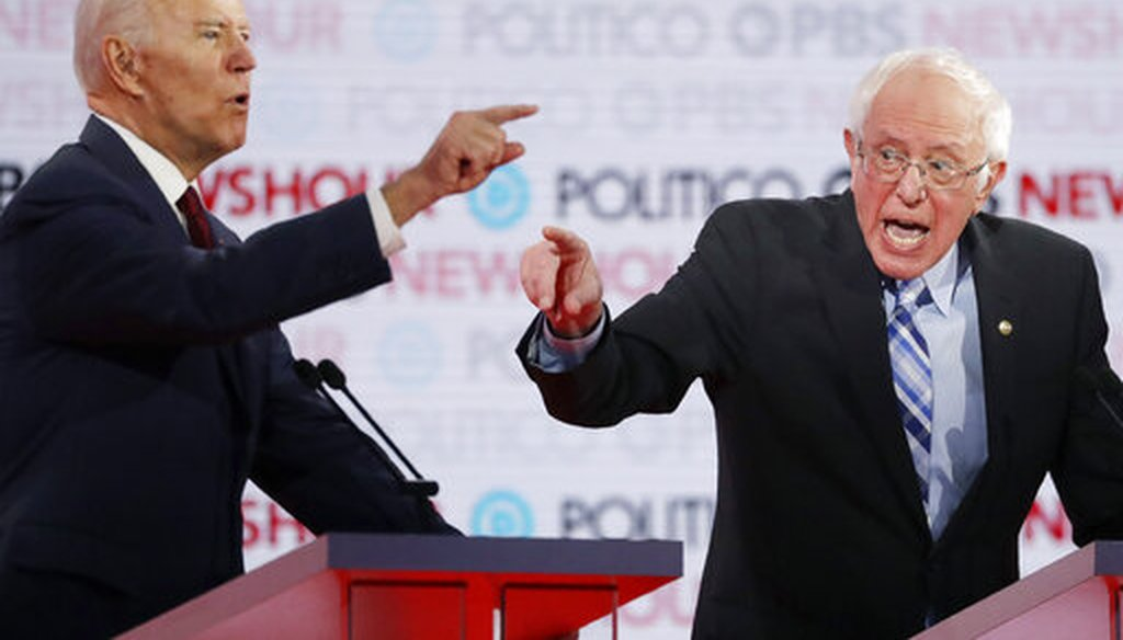 Democratic presidential candidates former Vice President Joe Biden, left, and Sen. Bernie Sanders, I-Vt., speak during a Democratic presidential primary debate Thursday, Dec. 19, 2019, in Los Angeles. (AP)