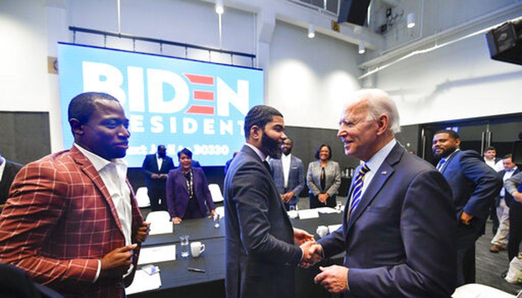 In this Nov. 21, 2019, file photo, former Vice President Joe Biden, right, walks around a meeting with Southern black mayors including Mississippi Mayor Chokwe Lumumba and Virginia Mayor Levar Stoney, in Atlanta. (AP)