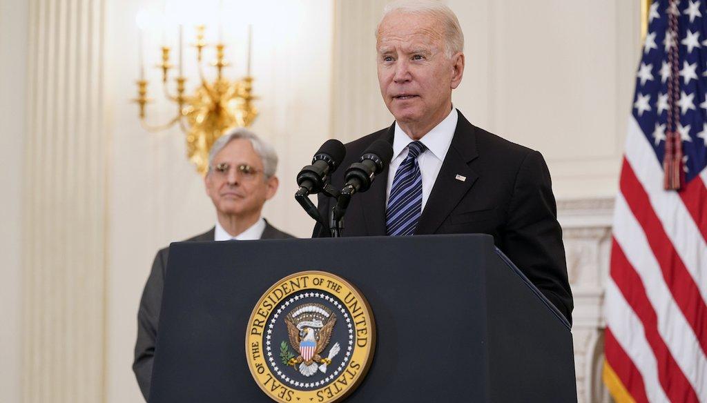 President Joe Biden discusses his gun crime prevention strategy as Attorney General Merrick Garland listens. (AP Photo/Susan Walsh)