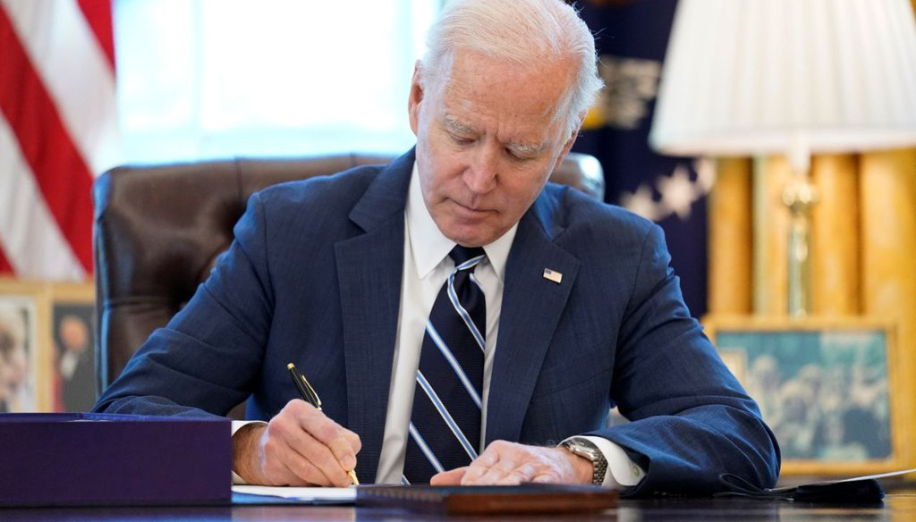 President Joe Biden signs the American Rescue Plan, a coronavirus relief package, in the Oval Office on March 11, 2021. (AP)