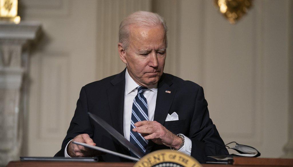 President Joe Biden signs a series of executive orders on climate change. (AP Photo/Evan Vucci)