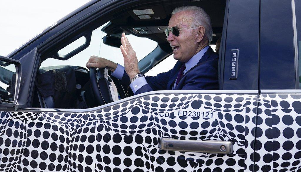 President Joe Biden test drives a Ford F-150 Lightning truck on Tuesday, May 18, 2021 (AP)