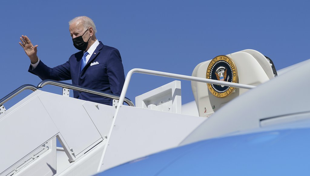 President Joe Biden waves as he boards Air Force One at Andrews Air Force Base, Md., Friday, March 26, 2021. Biden is spending the weekend at his home in Delaware. (AP)